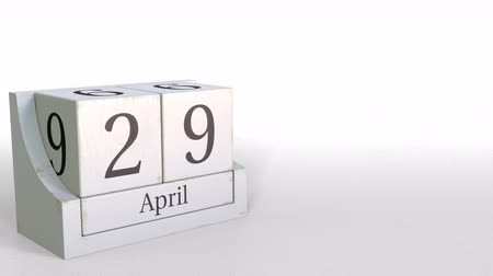 nove : April 29 date on vintage cube calendar, 3D animation Vídeos