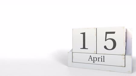 hoje : Cube calendar shows April 15 date. 3D animation