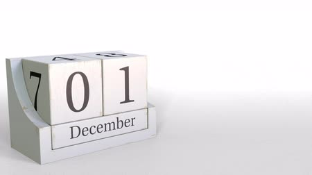 período : December 1 date on wooden blocks calendar. 3D animation