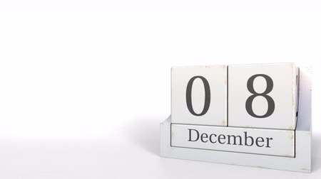 the conception : December 8 date on wood bricks calendar. 3D animation