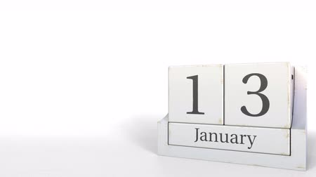 son teslim tarihi : Wood cube calendar shows January 13 date, 3D animation Stok Video