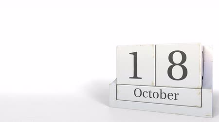 son teslim tarihi : Wood cube calendar shows October 18 date, 3D animation Stok Video