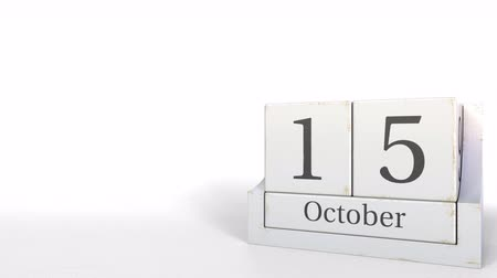 período : Wooden blocks calendar shows October 15 date, 3D animation