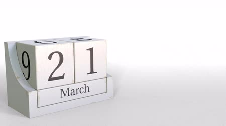 primeiro plano : Wooden blocks calendar shows March 21 date, 3D animation