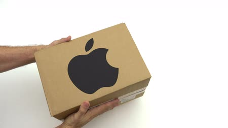 inc : Man holds box with APPLE INC logo. Editorial clip