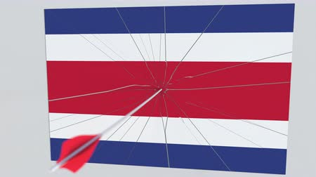 sertés : Archery arrow hits flag of COSTA RICA plate. Conceptual 3D animation Stock mozgókép