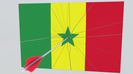 tiro com arco : Archery arrow breaks plate featuring flag of SENEGAL. 3D animation Stock Footage