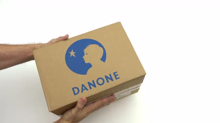 パック : Hands holding box with DANONE logo. Editorial clip