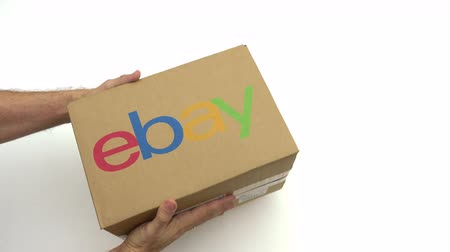 ebay : EBAY logo on the carton in hands. Editorial clip