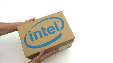 intel : Hands holding box with INTEL logo. Editorial clip Stock Footage