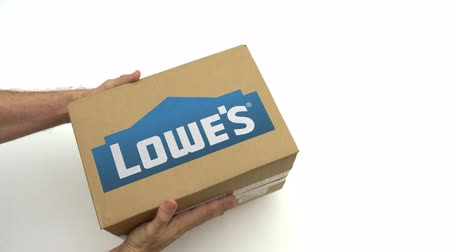 パック : LOWES logo on the carton in hands. Editorial clip 動画素材