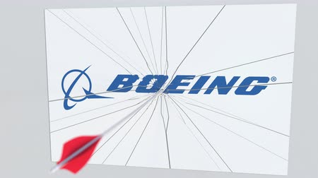 хит : BOEING company logo being hit by archery arrow. Business crisis conceptual editorial animation Стоковые видеозаписи