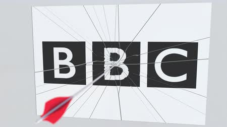 tiro com arco : Archery arrow hits plate with BBC logo. Corporate problems conceptual editorial animation Stock Footage