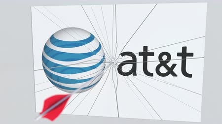 criticism : AT&T company logo being cracked by archery arrow. Corporate problems conceptual editorial animation