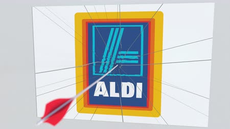 assalto : ALDI company logo being cracked by archery arrow. Corporate problems conceptual editorial animation