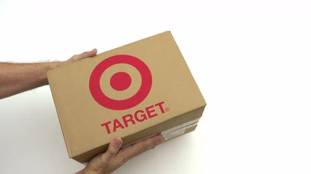 курьер : TARGET logo on the carton in hands. Editorial clip
