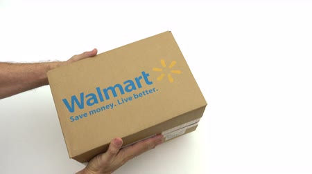 walmart : Hands holding box with WALMART logo. Editorial clip Stock Footage