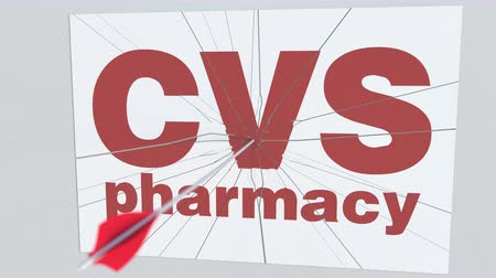 tiro com arco : Archery arrow breaks glass plate with CVS PHARMACY company logo. Business issue conceptual editorial animation Stock Footage