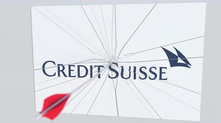 criticism : CREDIT SUISSE company logo being cracked by archery arrow. Corporate problems conceptual editorial animation Stock Footage