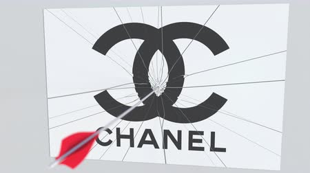 criticism : Archery arrow breaks glass plate with CHANEL company logo. Business issue conceptual editorial animation