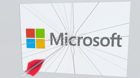 tiro com arco : MICROSOFT company logo being cracked by archery arrow. Corporate problems conceptual editorial animation