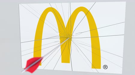 criticism : MCDONALDS company logo being cracked by archery arrow. Corporate problems conceptual editorial animation Stock Footage