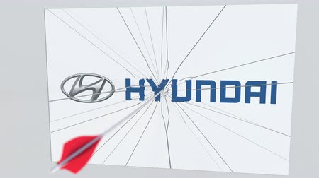 lukostřelba : HYUNDAI company logo being hit by archery arrow. Business crisis conceptual editorial animation