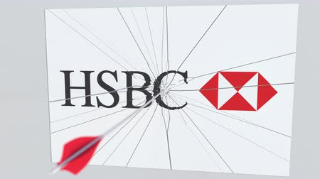 wina : HSBC company logo being cracked by archery arrow. Corporate problems conceptual editorial animation Wideo