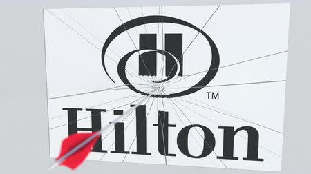criticism : Archery arrow hits plate with HILTON logo. Corporate problems conceptual editorial animation