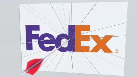 tiro com arco : Archery arrow breaks glass plate with FEDEX company logo. Business issue conceptual editorial animation Stock Footage