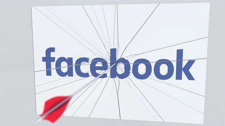 criticism : Archery arrow hits plate with FACEBOOK logo. Corporate problems conceptual editorial animation