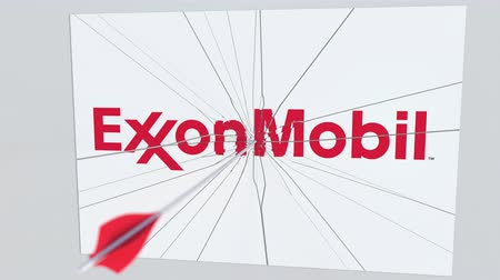 criticism : EXXON MOBIL company logo being cracked by archery arrow. Corporate problems conceptual editorial animation