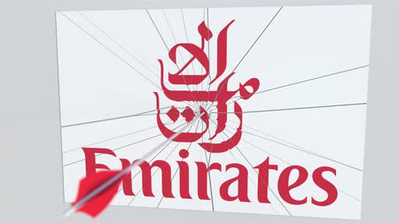 culpa : Archery arrow breaks glass plate with EMIRATES AIRLINES company logo. Business issue conceptual editorial animation Vídeos