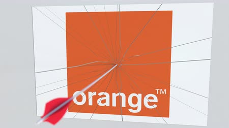 hiba : ORANGE company logo being hit by archery arrow. Business crisis conceptual editorial animation