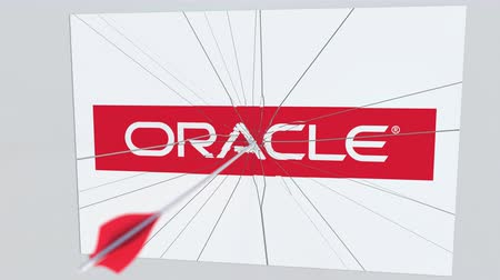 hiba : ORACLE company logo being hit by archery arrow. Business crisis conceptual editorial animation Stock mozgókép