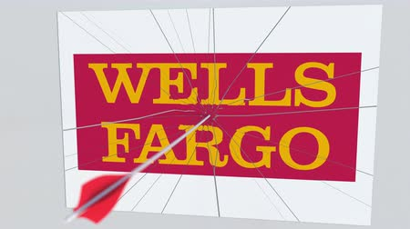 hiba : WELLS FARGO company logo being cracked by archery arrow. Corporate problems conceptual editorial animation Stock mozgókép