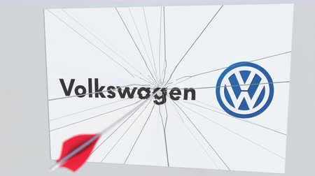 volkswagen : VOLKSWAGEN company logo being cracked by archery arrow. Corporate problems conceptual editorial animation