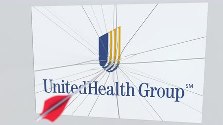 culpa : UNITEDHEALTH GROUP company logo being hit by archery arrow. Business crisis conceptual editorial animation