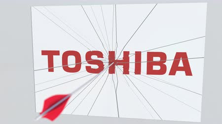 redazione : Archery arrow breaks glass plate with TOSHIBA company logo. Business issue conceptual editorial animation