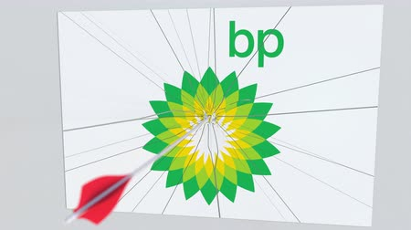 tiro com arco : Archery arrow breaks glass plate with BP company logo. Business issue conceptual editorial animation Stock Footage