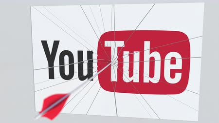 criticism : Archery arrow breaks glass plate with YOUTUBE company logo. Business issue conceptual editorial animation