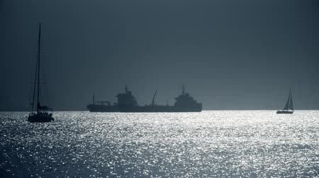 námořník : Silhouettes of sailboats and cargo ship near Gibraltar