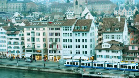 water rail : ZURICH, SWITZERLAND - DECEMBER 15, 2018. City tram moves along the Limmat river embankment
