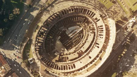 amphitheatre : Aerial top down hyperlapse of crowded Colosseum or Coliseum amphitheatre in Rome, main landmark of the city and Italy