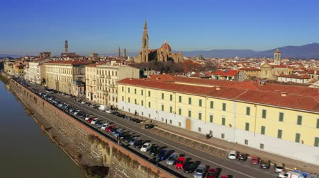 heritage : Aerial view of the Arno river embankment towards Florence Cathedral or Cattedrale di Santa Maria del Fiore. Italy