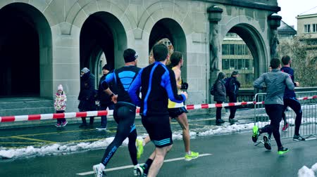 deneme : ZURICH, SWITZERLAND - DECEMBER 16, 2018. Slow motion shot of winter marathon runners
