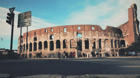 gladiatorial : Time lapse of crowded square near famous Colosseum or Coliseum amphitheatre in Rome, Italy