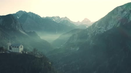 итальянский : Aerial view of Church of San Martino and foggy valley in northern mountains in Valle di Cadore, Italy
