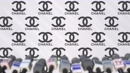 declaring : CHANEL company press conference, press wall with logo and mics, conceptual editorial animation Stock Footage