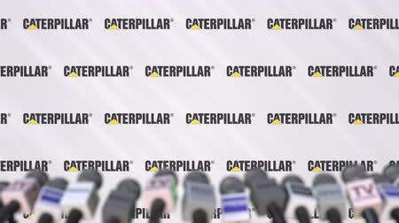 declaring : Media event of CATERPILLAR, press wall with logo and microphones, editorial animation Stock Footage